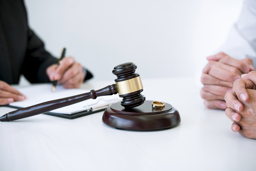 gavel with two people discussing a case